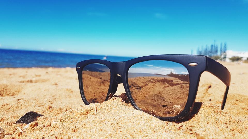 Close-Up Of Sunglasses On Beach