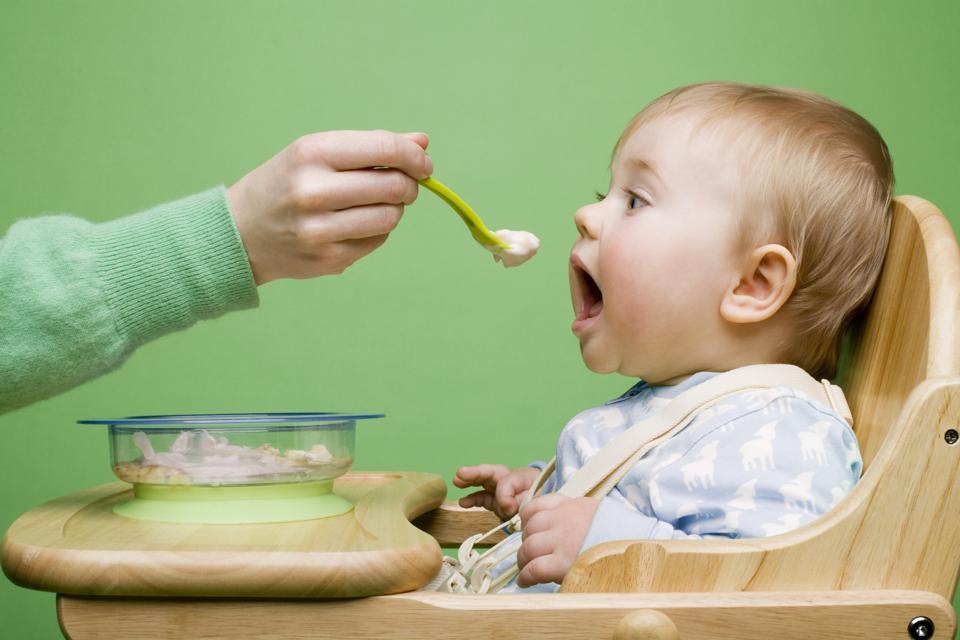 Adult feeding baby