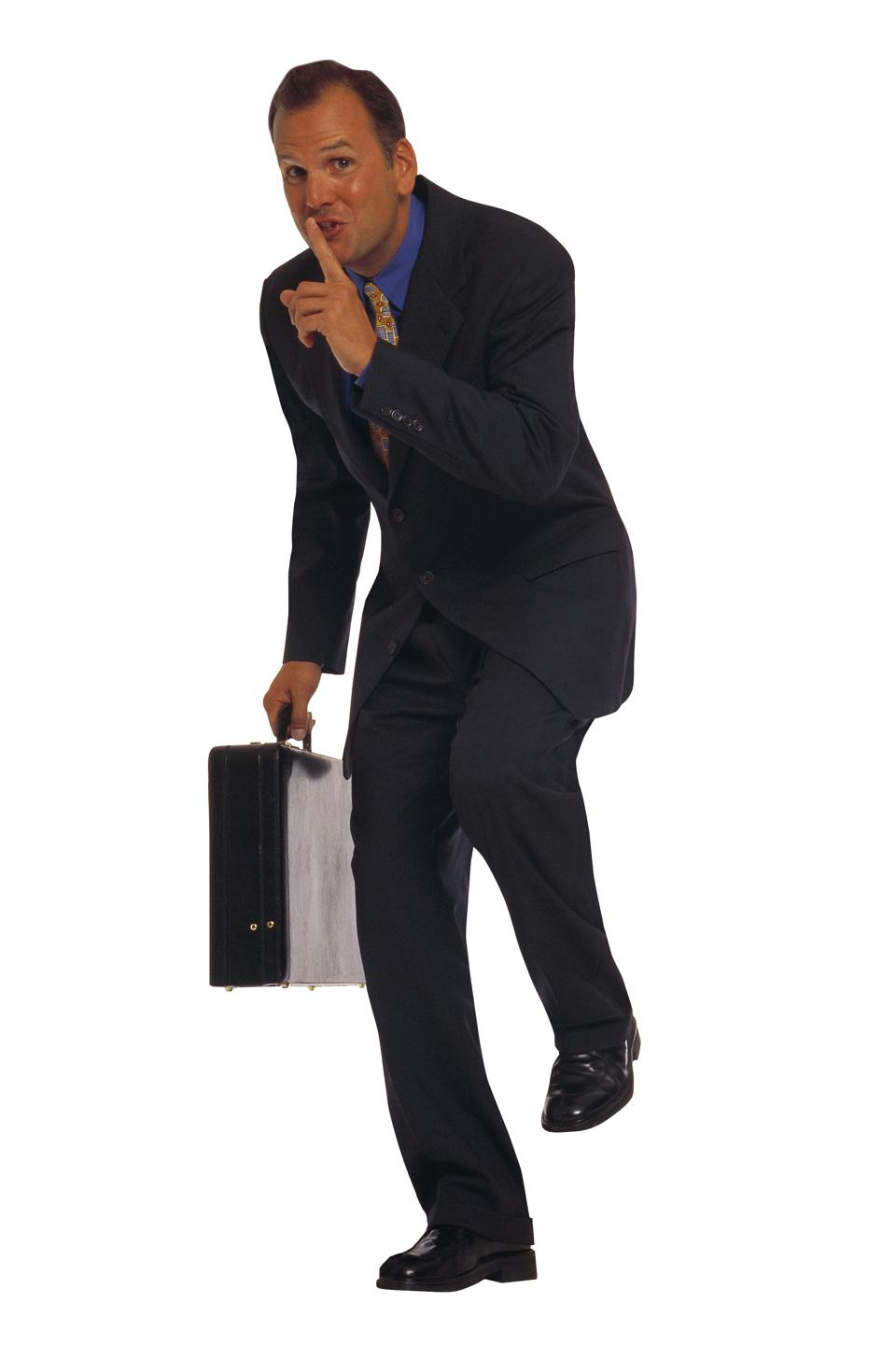 Businessman with briefcase sneaking around
