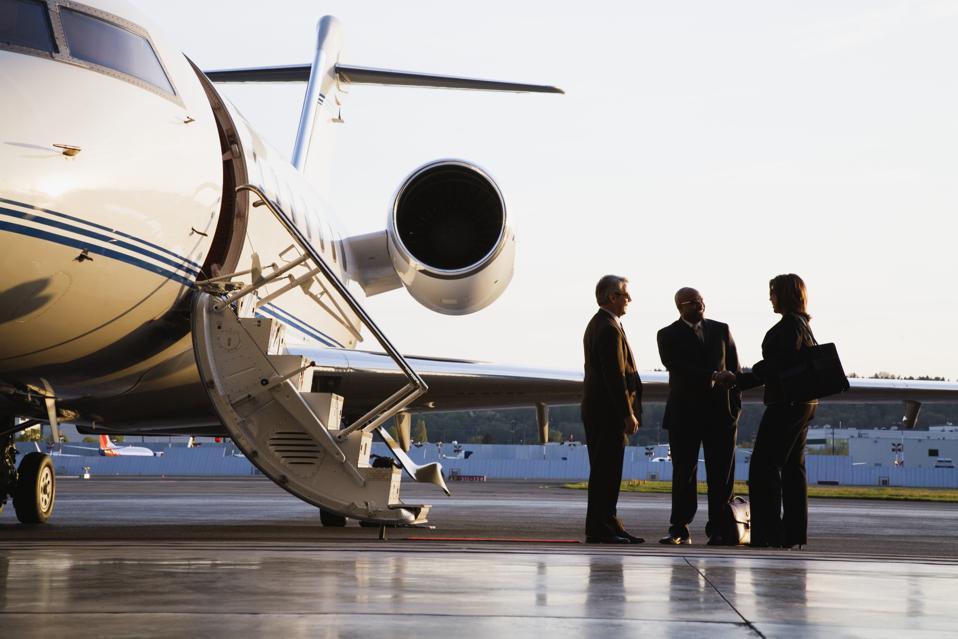 Businesspeople Boarding Executive Jet
