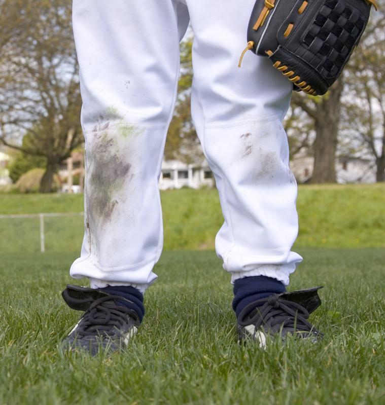 Young boy's dirty baseball uniform