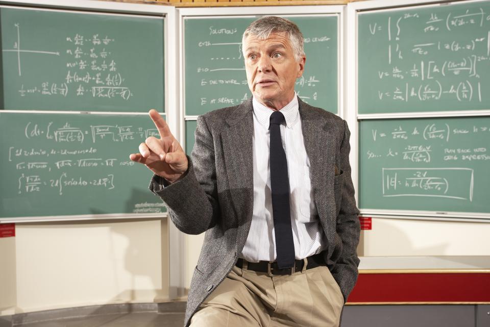 Teacher in front of blackboard