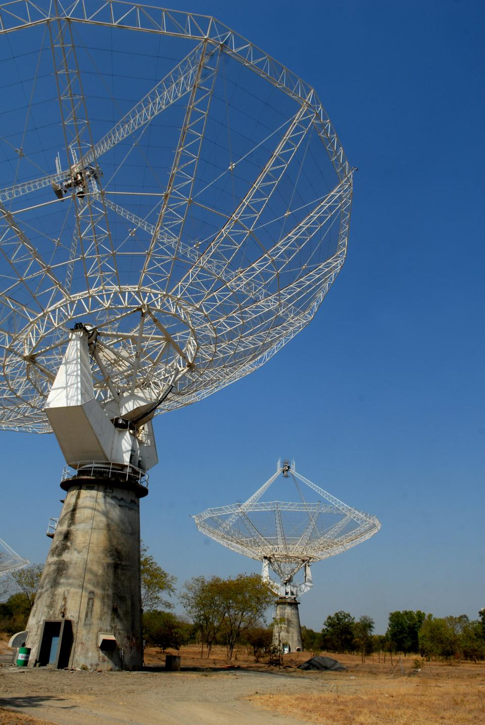 The GMRT near Pune in India has 30 dishes that operate individually as telescopes, and collectively, which make the GMRT the world's largest radio telescope in the 150-1,500 Mhz frequency. (Photo by Hemant Mishra/Mint via Getty Images)