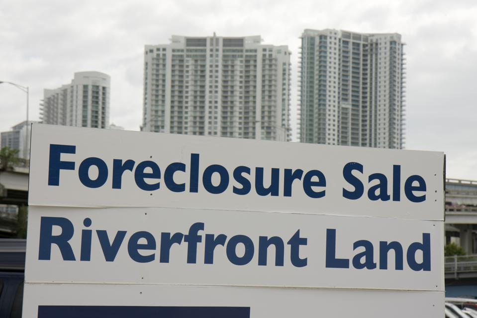 A foreclosure sale, riverfront land sign