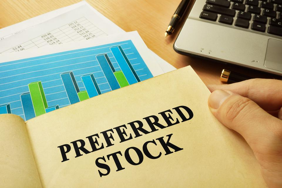 Book with page about preferred stock. Trading concept.