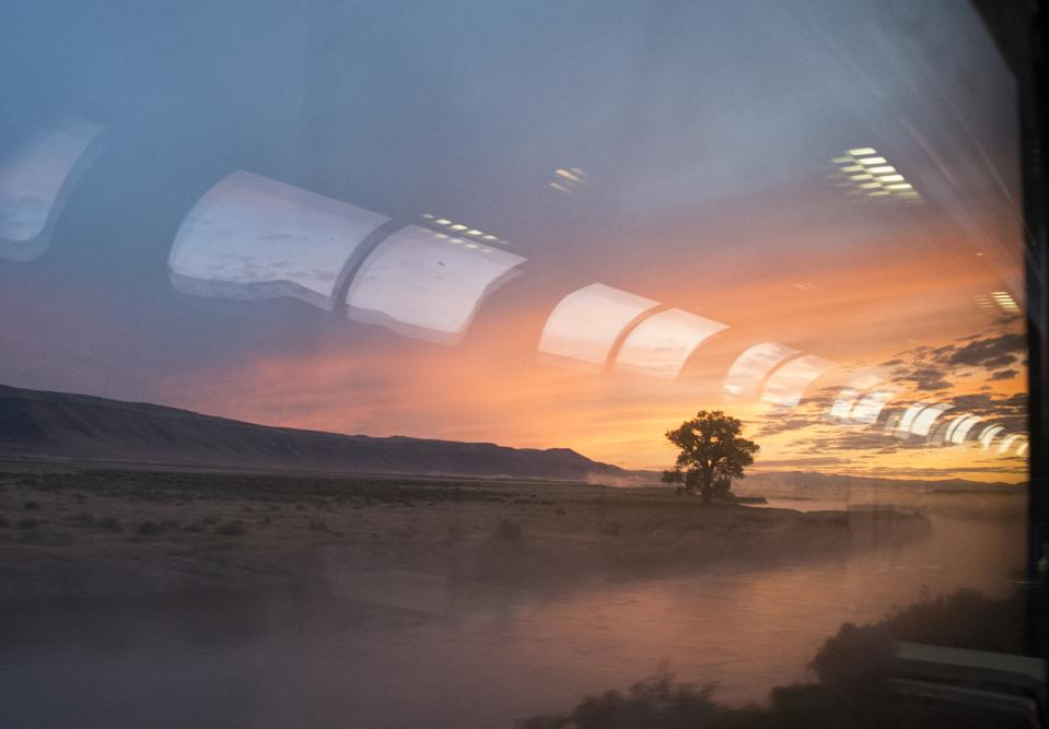 Sunrise in eastern Colorado, seen from the lounge car of the Amtrak train California Zephyr.
