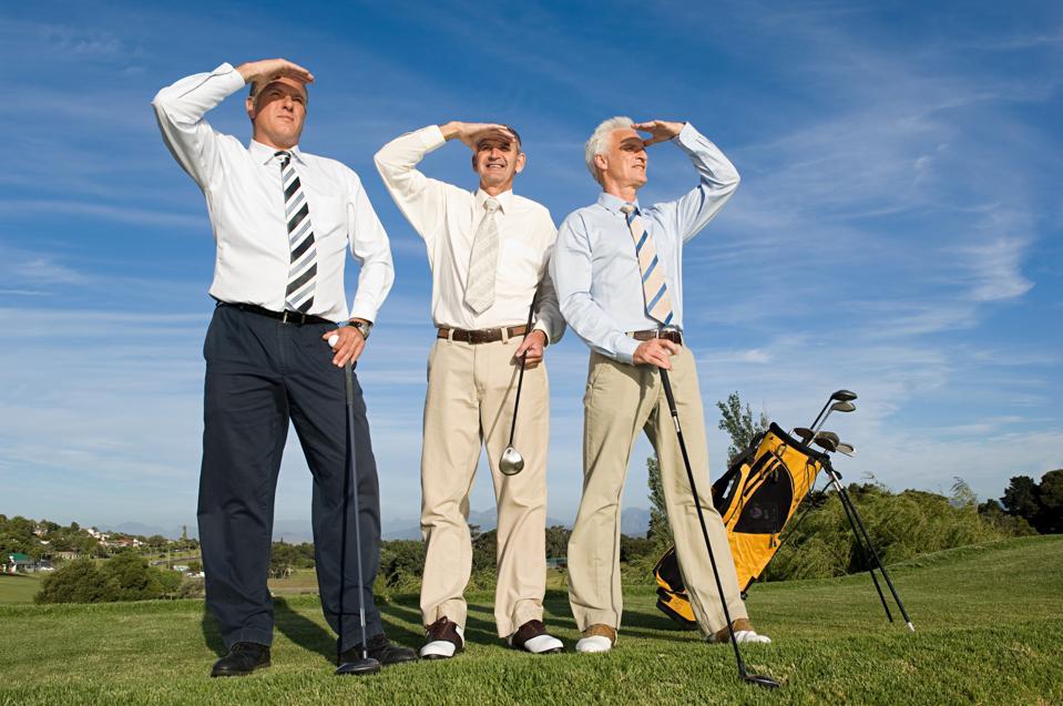 Businessmen playing golf