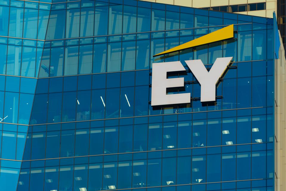 EY logo or sign in modern downtown skyscraper. EY is a...