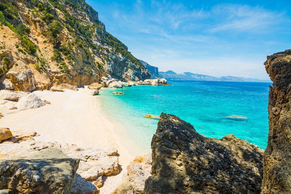 Rocks and sand in Cala Mariolu