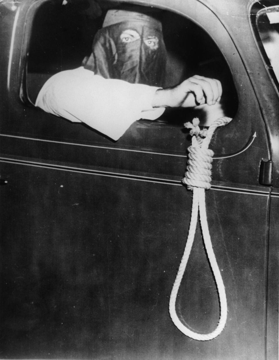 Member of the Ku Klux Klan with a noose, 75 cars of the Ku Klux Klan were driving through Miami, Florida to hold off black people form the election, Photograph, May 11th 1939