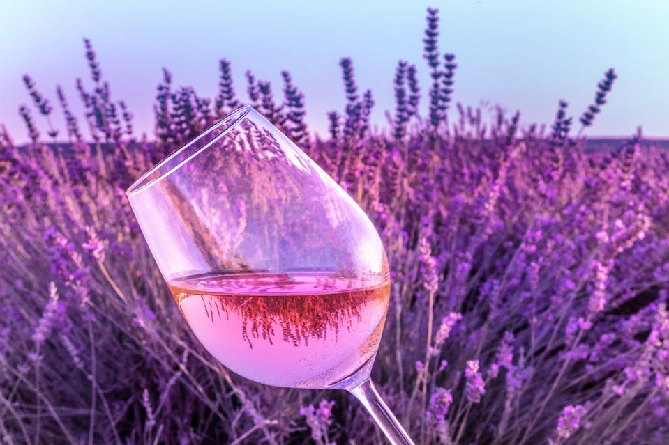 Glass of rose wine in lavender field