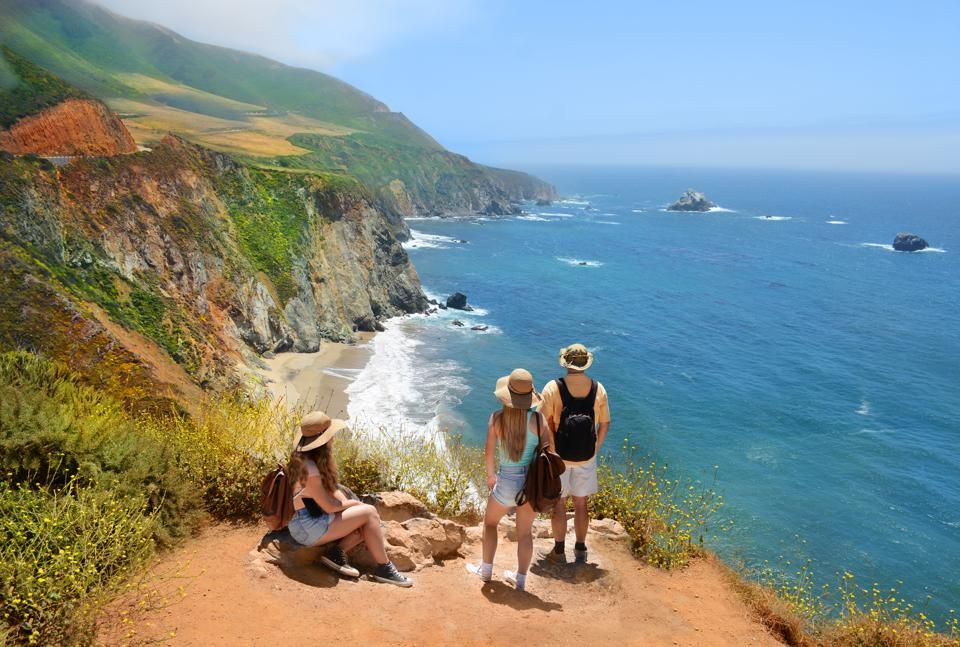Family looking at beautiful summer mountains landscape, on hiking trip