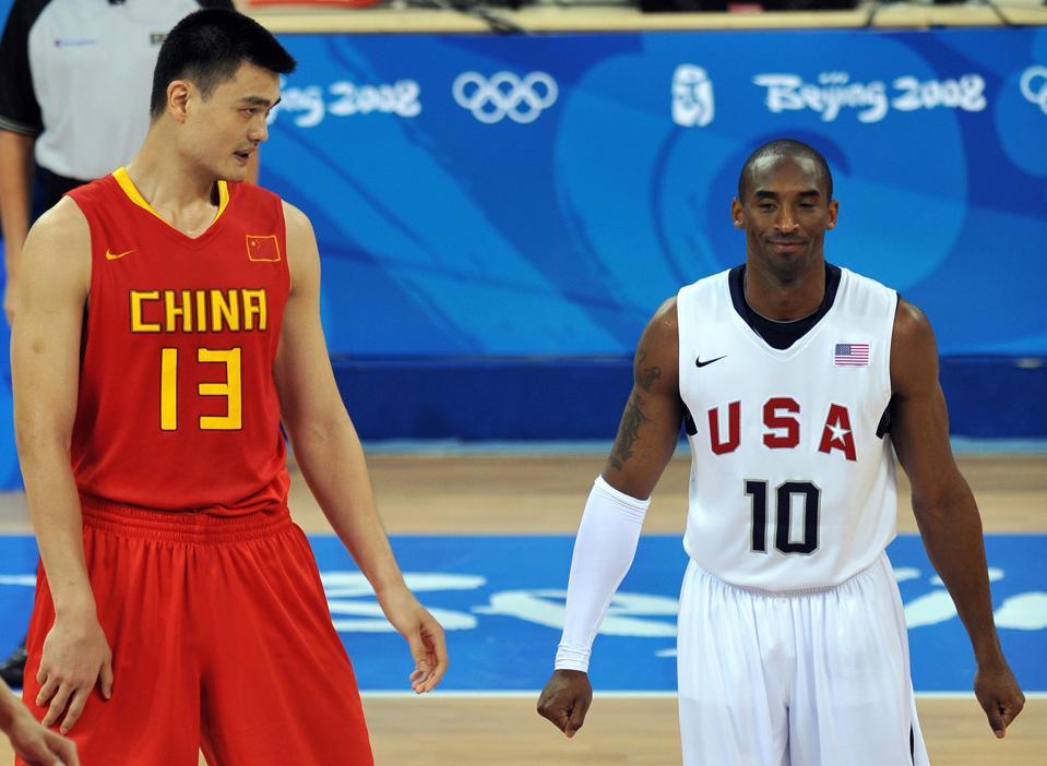 China's Ming Yao (L) walks next to Kobe