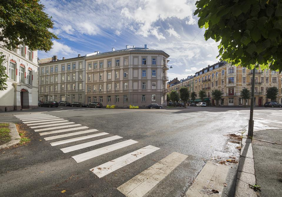 A quiet intersection and crosswalk in Oslo, Norway.