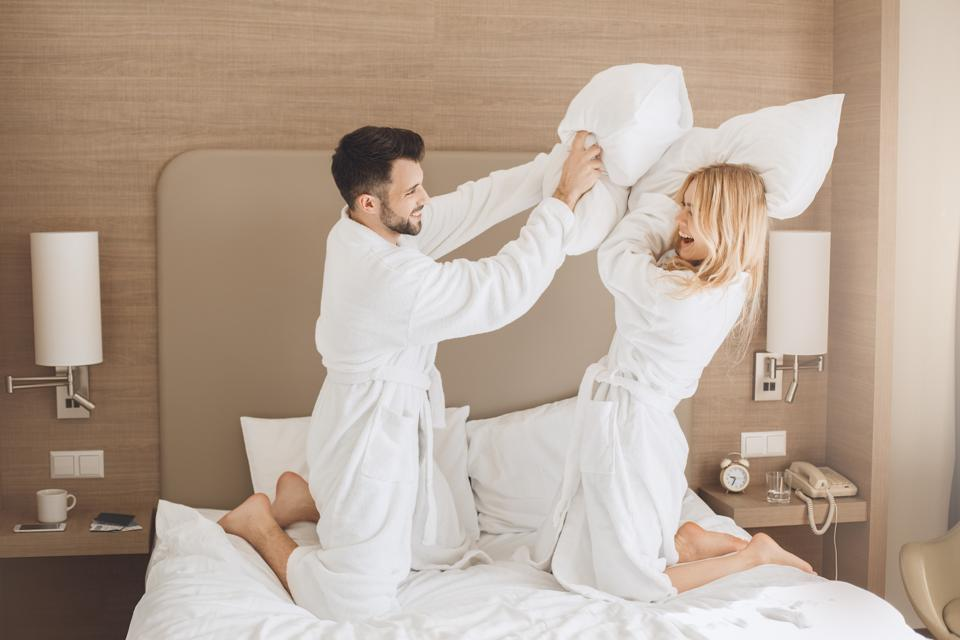 Young couple travels together hotel room leisure. This couple also fought over the hotel bill.
