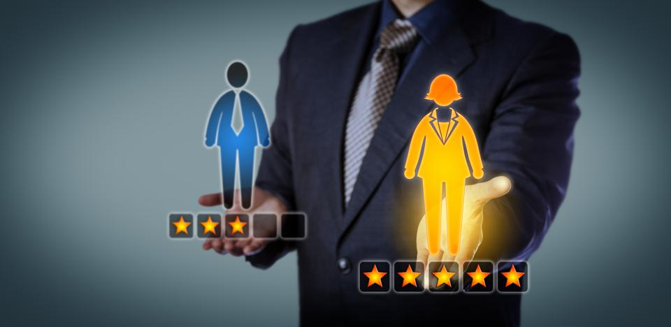 Recruiter Rating Employee With Five Stars