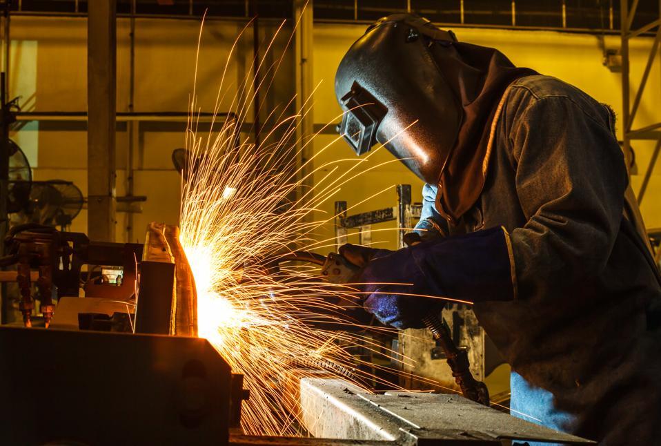 welder, welding automotive part in a car factory
