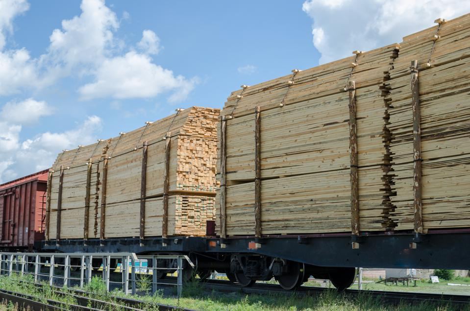 Full train cars loaded with timber