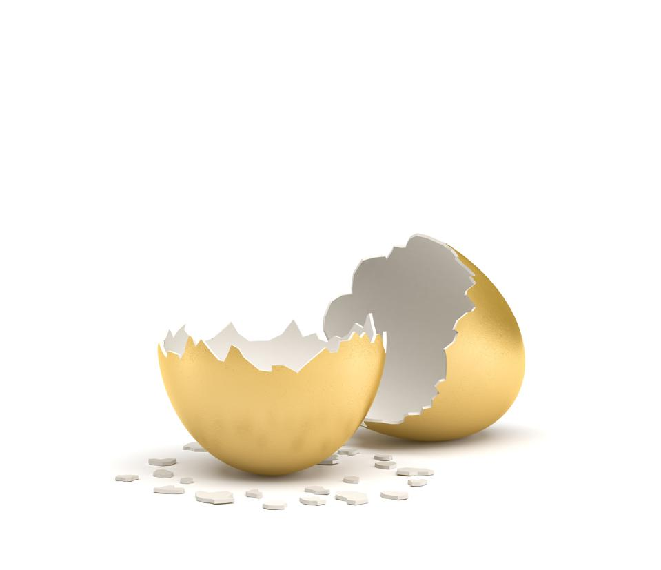 3d rendering of a cracked golden egg with its two pieces lying beside each other on white background