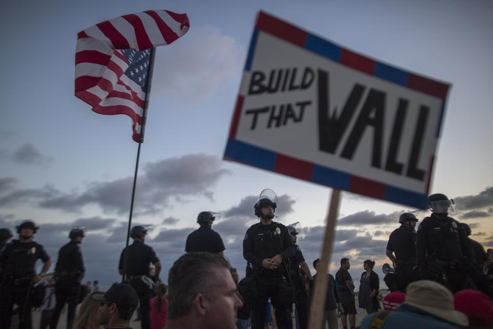 Activists For Stricter Immigration Polices And Counter-Protesters Demonstrate In Laguna Beach