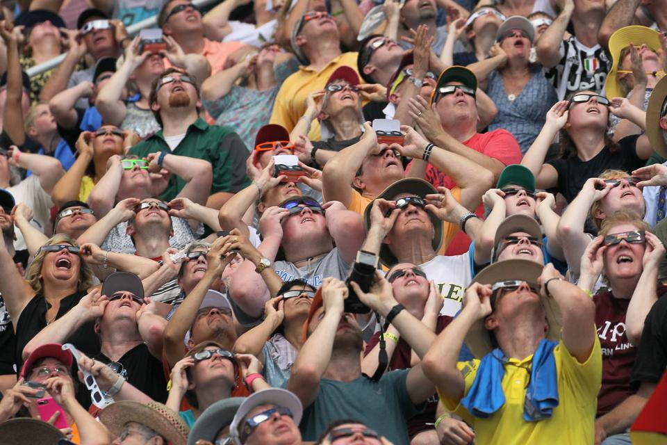 People watch the solar eclipse at Saluki Stadium on the campus of Southern Illinois University on August 21, 2017 in Carbondale, Illinois. (Photo by Scott Olson/Getty Images)