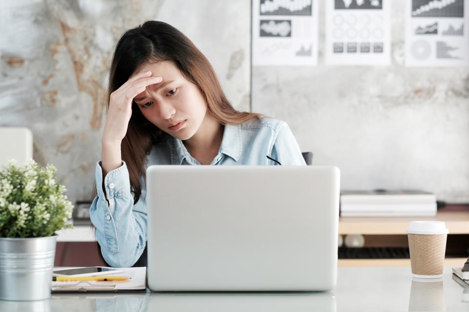 Stressed business professional thinking of quitting her job? Five reasons not to quit even a job you hate