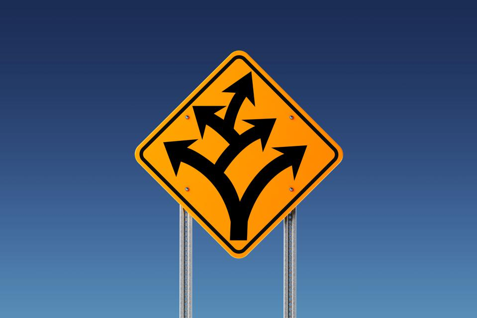 Yellow Branching Off or Division Ahead Traffic Sign on Blue Sky