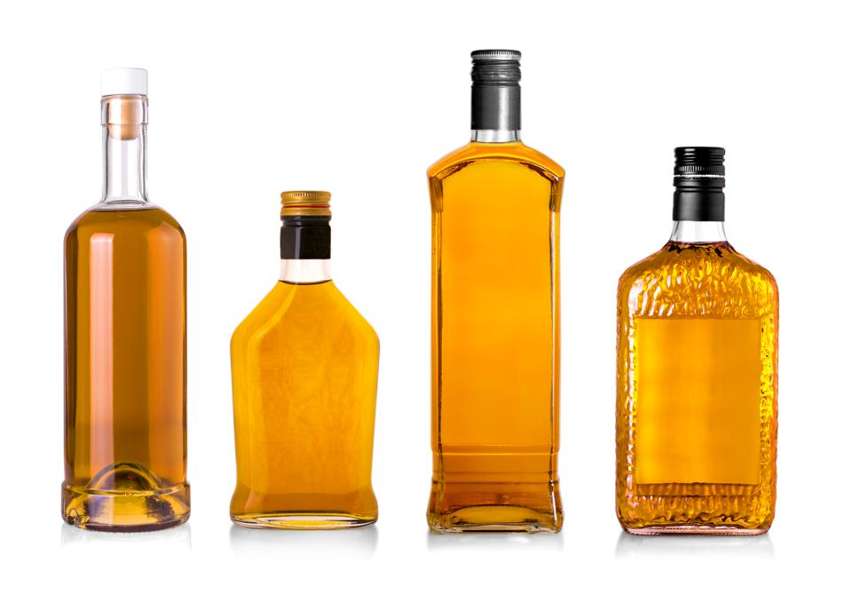 Set of Beautiful Whisky Bottles against well lit background.