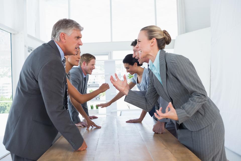 Irritated business team arguing