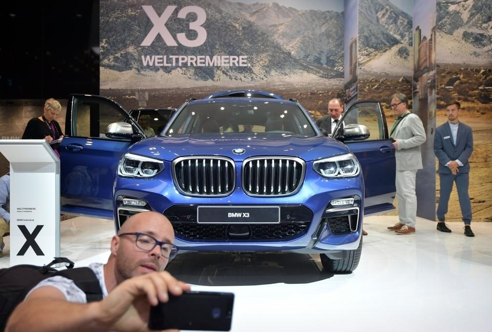 Visitor look to a BMW X3 car at the 2017 Frankfurt Auto Show on September 12, 2017 in Frankfurt am Main, Germany. (Photo by Thomas Lohnes/Getty Images)