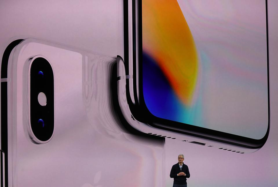 Apple CEO Tim Cook speaks during an Apple special event at the Steve Jobs Theatre to launch the new iPhone range (Photo by Justin Sullivan/Getty Images)