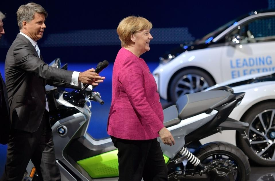 Former BMW CEO Harald Krueger is pictured with former German Chancellor Angela Merkel
