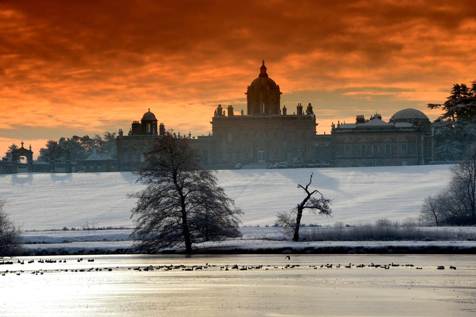 A Sub zero sunrise over Castle Howard the stately Home made famous in Brideshead Revisited. The lake in front of Castle Howard is now almost completely frozen over as the severe winter weather continues.   (Photo by John Giles/PA Images via Getty Images)