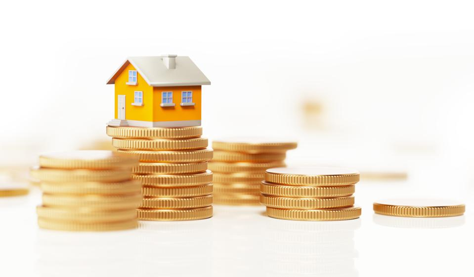 Yellow Toy House Sitting On Top Of Coin Stack: Real Estate and Savings Concept