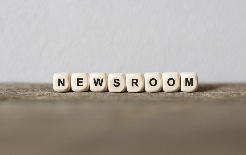 Word NEWSROOM made with wood building blocks
