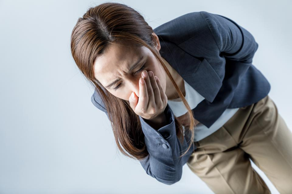 young woman feeling nauseated.