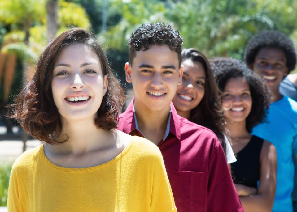 Caucasian and latin and african american and hispanic young adults in a row