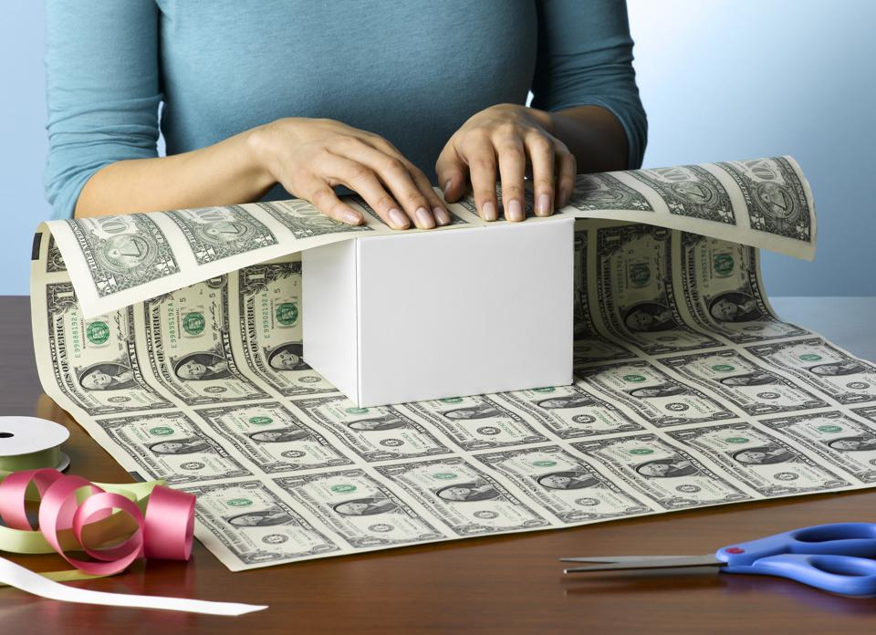 Woman Wrapping Present in Money