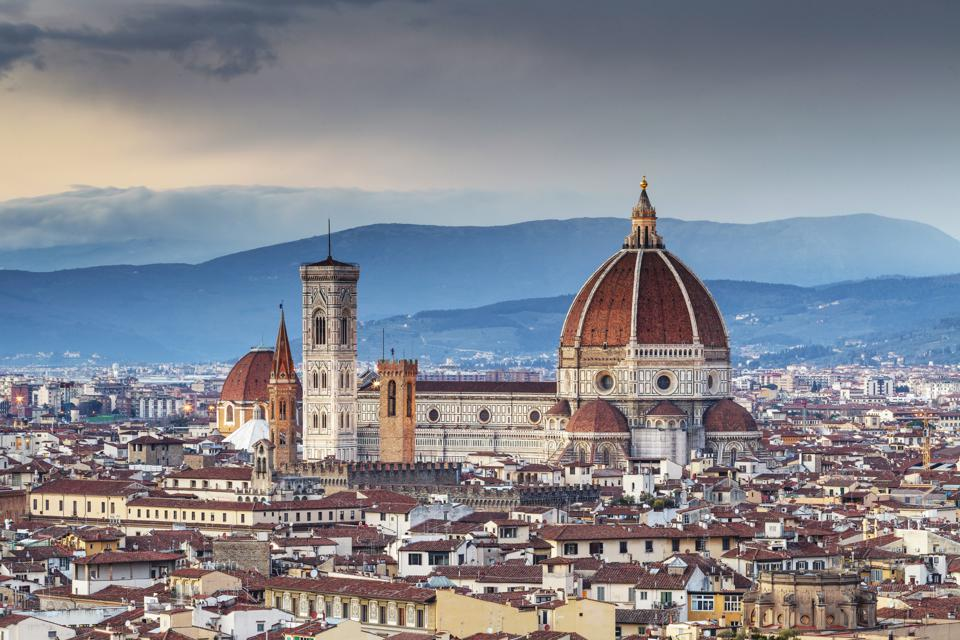 The view from Piazzale Michelangelo over to the historic city of Florence at dusk.