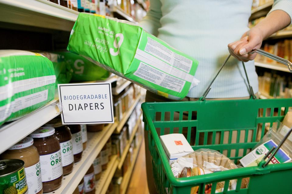 Woman shopping for biodegradable diapers