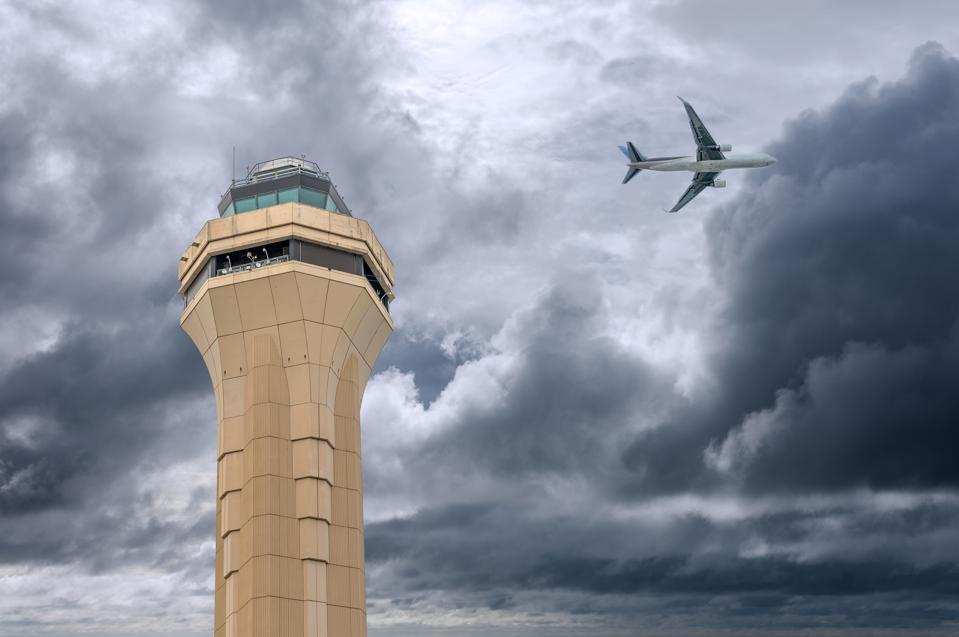Miami air traffic control tower in stormy day.