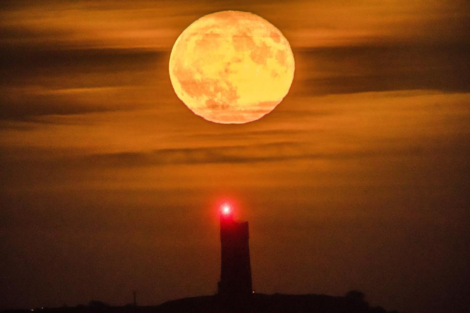 A full November moon rises behind the Victoria Tower on the summit of Castle Hill in Huddersfield, UK in November 2017. (Photo by Danny Lawson/PA Images via Getty Images)