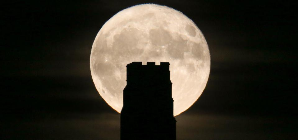 A full November moon rises behind St Michael's Tower on the top of Glastonbury Tor on November 4, 2017 in Somerset, England (Photo by Matt Cardy/Getty Images).