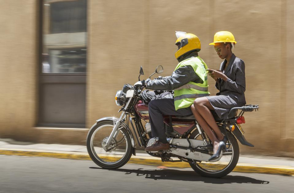 Business woman on a moto taxi