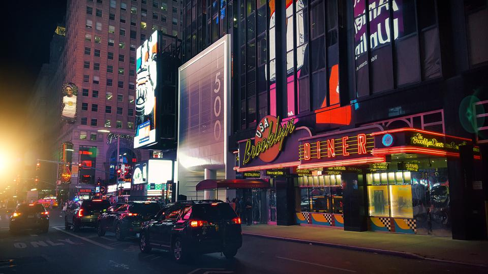 Cars driving along West 43rd Street near Times Square, Midtown Manhattan, New York City