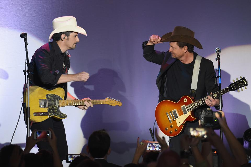 Brad Paisley and Michael J. Fox play together at the Fox Foundation's 2017