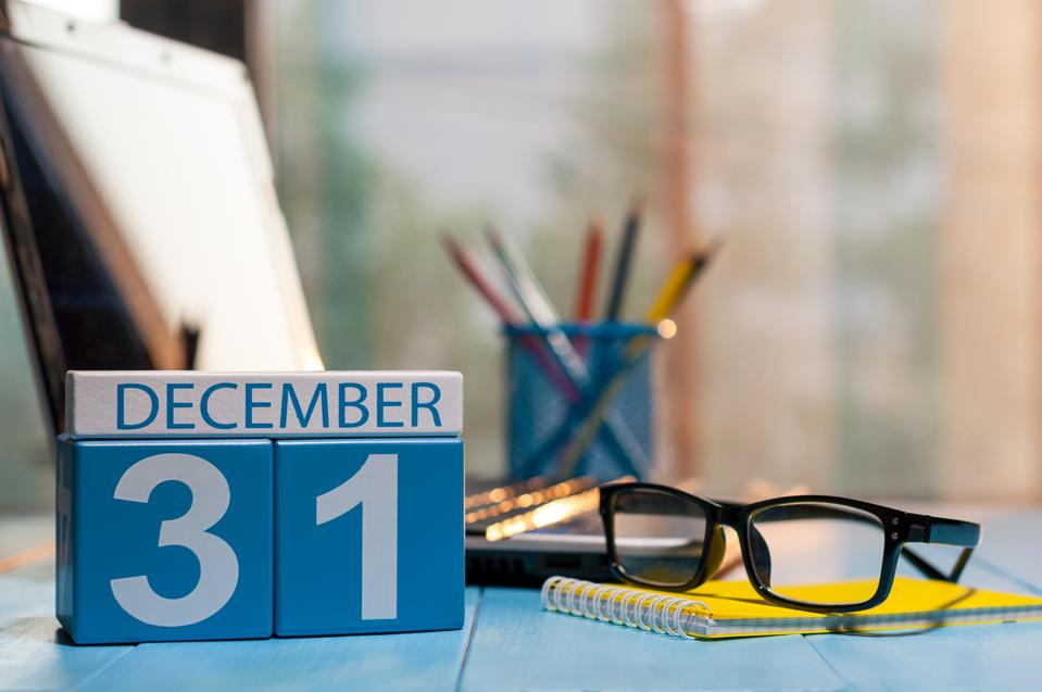 December 31st. Day 31 of month, calendar on workplace background. New year at work concept. Winter time.