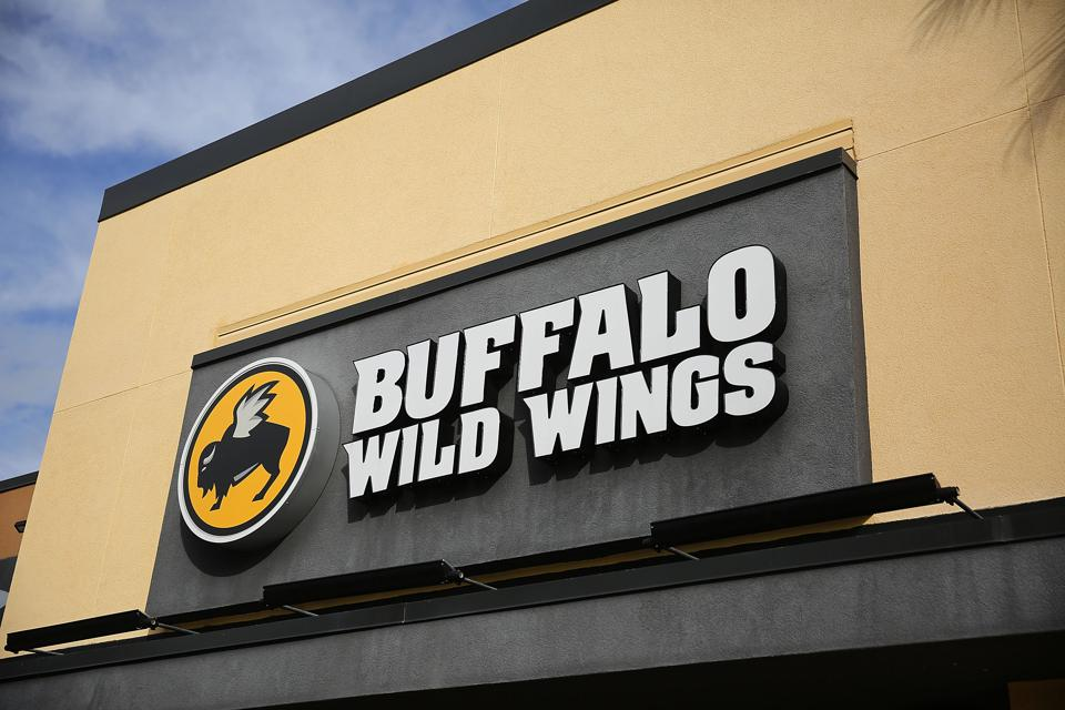 Buffalo Wild Wings has new menu items, restaurant redesigns and campaigns ahead of football season. (Photo by Joe Raedle/Getty Images)