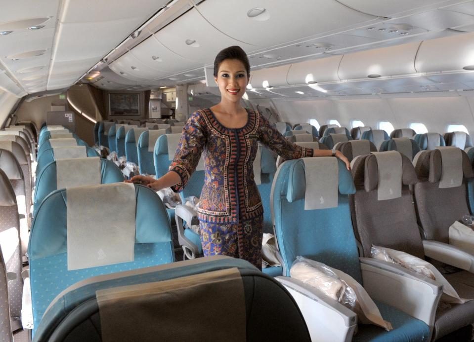 An air hostess poses in the economic cla