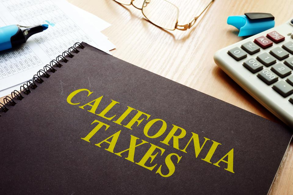 Book with California taxes on a desk.